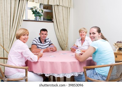 family playing cards together in living room
