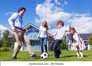 family playing football in front of their house