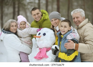 family playing in fresh snow