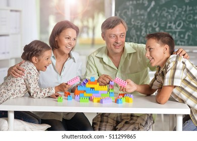 Family playing lego game