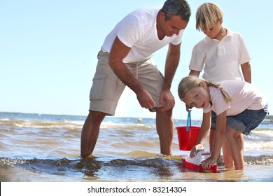 Family playing in the sea
