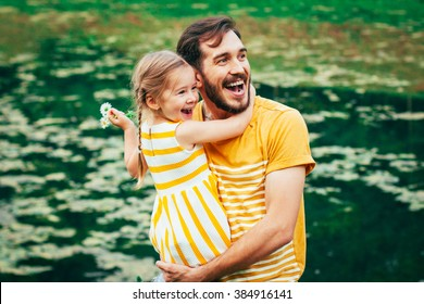 Family portrait. Father with  daughter