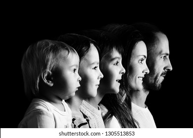 Family portrait of father, mother and three boys, profile picture of them all in a row, isolated on black background, monochrome version
