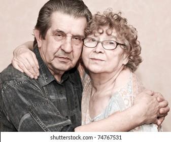 family portrait of great elderly people hugging