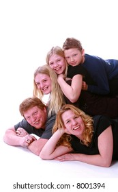 Family portrait with kids piled on dad