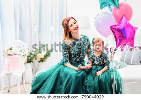Mother And Daughter Are Dressed In Lush Dresses Shooting The Studio