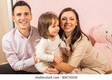 Family portrait with mother father and daughter