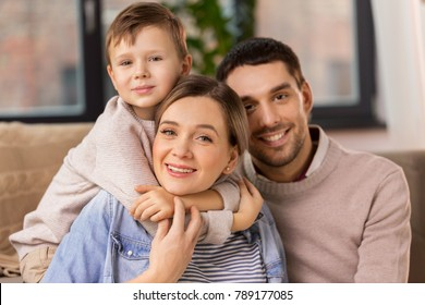 family, portrait and people concept - happy little son with mother and father at home