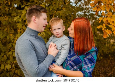 family portrait of three in a fall