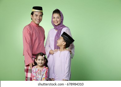 family portrait with traditional outfit with copyspace