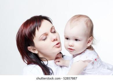 Family portrait of a young beautiful mother holding cute baby