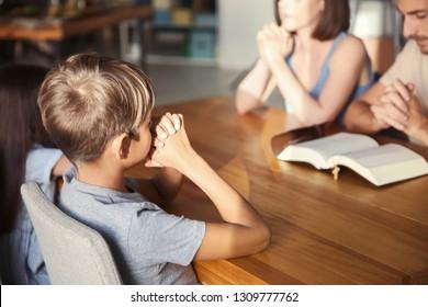 Family praying at home