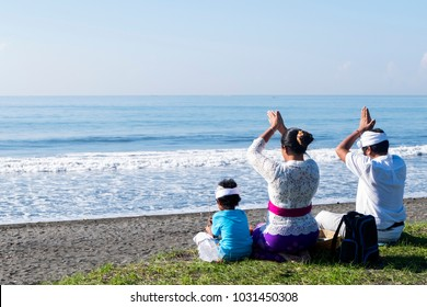 The family was praying together on the beach