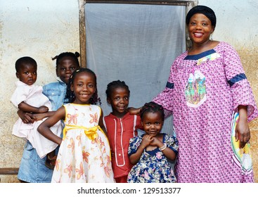 Family with pregnant African woman with five daughters