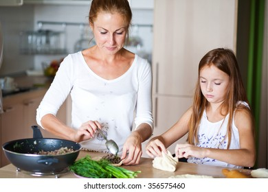 family preparing breakfast, girl and daughter makes cake cooking
