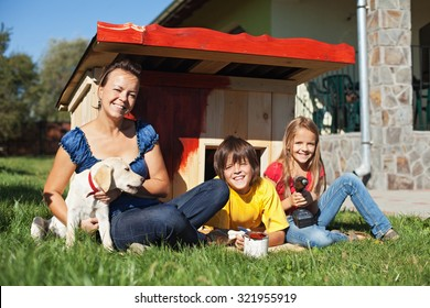 Family preparing the doghouse for the new family member - a labrador puppy
