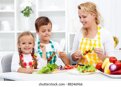 Family preparing a fresh vegetables meal together in the kitchen