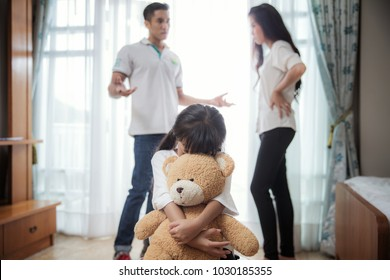 Family problem, father and mather is fighting but daughter very sad, this picture can use for kid and children problem, family broken concept