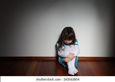 Family problems - intimidated sad little girl