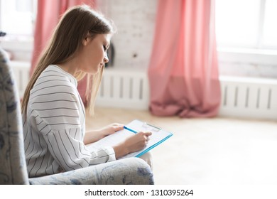 Family Psychologist. A woman consults and writes in a notebook.