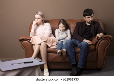 family psychotherapy. family on reception at the psychologist. My parents are fighting. Childhood traumas. Conflicts in the family. Couple arguing at therapy session in therapists office.