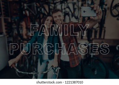 Family Purchases. Customers Choosing a Bicycle for Himself. Customers is Couple of Man and Woman. Couple Doing Selfie on Smartphone. Woman Sitting on Bicycle. People Happy and Smiling. Bicycle Shop.