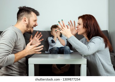 Family quarrel, poma and dad swear in the background of the son who does not like it, the child cries. The concept of family problems, the psyche of the child, domestic violence.