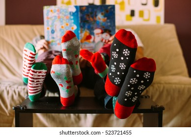 family reading book with children, christmas socks