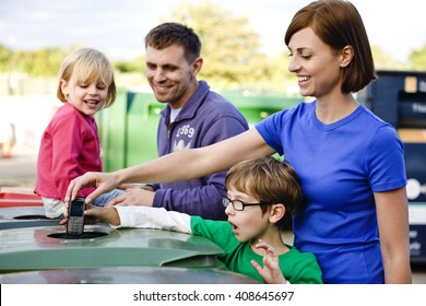 A family recycling a mobile phone
