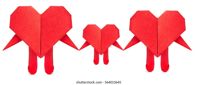 Family of red heart origami, isolated on white background.