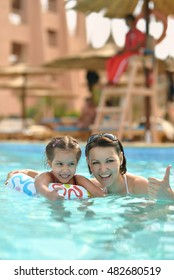 Family relax in the pool