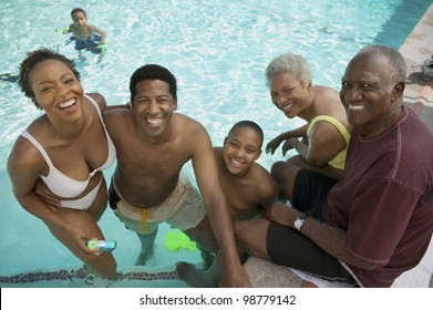 Family Relaxing in Swimming Pool