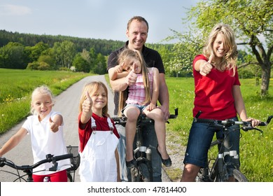 Family riding bicycles in spring