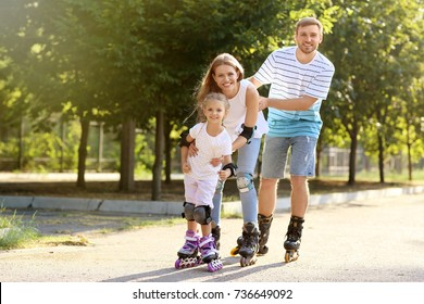 Family rollerskating in park