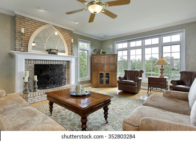 Family room in luxury home with large brick fireplace