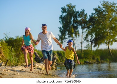 Family run along Beach. Holiday and Travel Concept