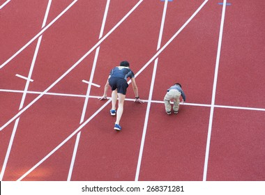 family  running on the track in stadium