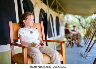 Family in safari tent enjoying vacation in Africa