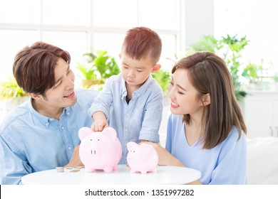 Family saving money and putting coins into piggy bank