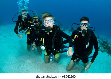 family of scuba divers