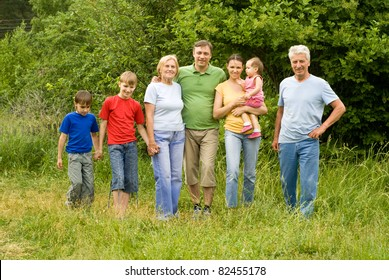 family of a seven people at nature
