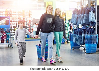Family with a shopping cart in a sport goods store