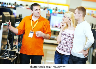 family shopping at electronics supermarket