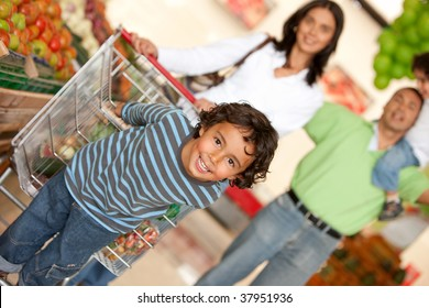 Family shopping for some groceries at the supermarket