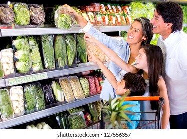Family shopping at the supermarket and kids helping out