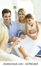 Family signing contract with home seller