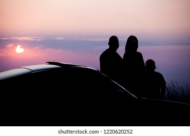 Family silhouette and sports car