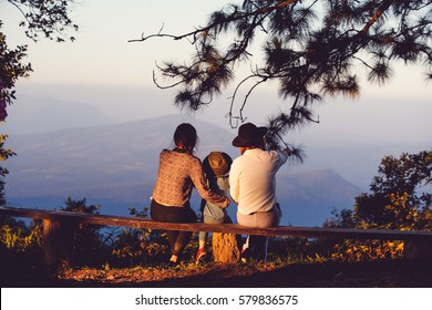 Family sitting benches views.