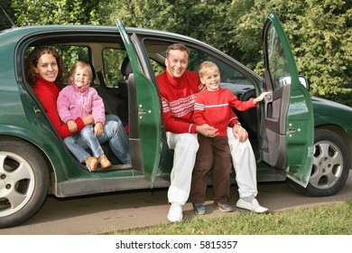 family sitting in car