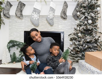 Family sitting in front of Christmas tree